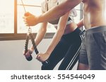 personal trainer showing an... | Shutterstock . vector #554544049