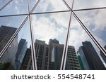 reflection of city office... | Shutterstock . vector #554548741