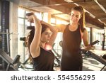 sporty girl doing weight... | Shutterstock . vector #554556295