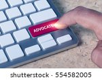 Small photo of Man pressed keyboard button with advocate word