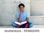 laughing african young adult... | Shutterstock . vector #554602441