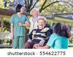 happy nurses and patients in... | Shutterstock . vector #554622775