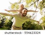 family  parenthood  fatherhood...   Shutterstock . vector #554623324