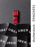 Small photo of OXFORD, UK - JANUARY 12th 2017: A photograph of the Uber logo. Uber is a popular taxi style transport service application, founded in 2009
