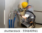 hands of plumber with a wrench. ... | Shutterstock . vector #554640961