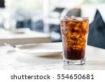 iced cola glass on the table | Shutterstock . vector #554650681
