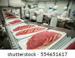 close up of raw pork meat at... | Shutterstock . vector #554651617