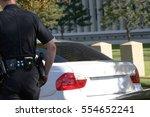 rear view of traffic officer... | Shutterstock . vector #554652241