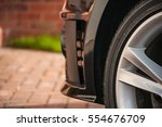 Small photo of Car Wheel Alloy, Black Tyre close up