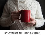 a man is holding a red mug | Shutterstock . vector #554684884