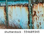 A Rusty Fence At An Abandoned...