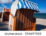 sandy beach and traditional... | Shutterstock . vector #554697505