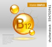 vitamin b12 gold shining pill... | Shutterstock .eps vector #554703961