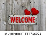 red welcome sign hanging by... | Shutterstock . vector #554716021