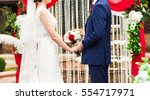 couple getting married at an... | Shutterstock . vector #554717971