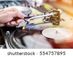 dj playing and mixes track on... | Shutterstock . vector #554757895