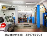 Small photo of Garage service workshop with tools, hydraulic platform elevator, tools, equipment and car detail