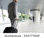 businessmen habds hold luggage... | Shutterstock . vector #554777839