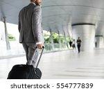businessmen habds hold luggage... | Shutterstock . vector #554777839