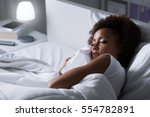 young african woman sleeping in ... | Shutterstock . vector #554782891