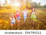 four happy beautiful children... | Shutterstock . vector #554790211