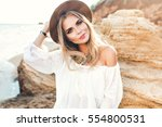 portrait of attractive blonde... | Shutterstock . vector #554800531