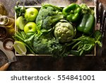 variety of green vegetables and ... | Shutterstock . vector #554841001