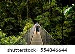 man walking on a hanging bridge ... | Shutterstock . vector #554846644