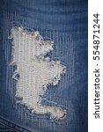 blue torn denim jeans texture. | Shutterstock . vector #554871244