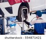 auto mechanic working in car... | Shutterstock . vector #554871421