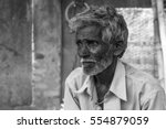indian grey haired old man with ... | Shutterstock . vector #554879059