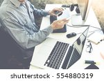 male hands working on computer... | Shutterstock . vector #554880319