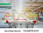 supermarket aisle with empty... | Shutterstock . vector #554899459