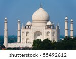 The white marble of the Taj Mahal is seen from a distance shining brilliantly during the daytime. - stock photo