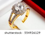 Close Up Gold Diamond Ring In...