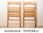 two wooden folding chair... | Shutterstock . vector #554928811