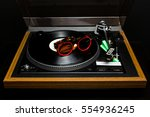 Small photo of Vintage 1970s record player with a sunglasses over the acetate disc, Dj accessories