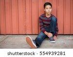 Sad Teen Asian Boy Sitting...