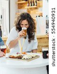 portrait of brunette tasting... | Shutterstock . vector #554940931