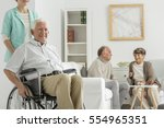 retirement home with elder man... | Shutterstock . vector #554965351
