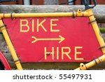bike hire sign on a battered and peeling frame - stock photo