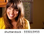happy woman laughing. | Shutterstock . vector #555015955
