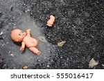 Abandoned Baby Doll In The...