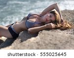 the girl lies on stones by the... | Shutterstock . vector #555025645