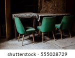 chairs in an abandoned factory... | Shutterstock . vector #555028729