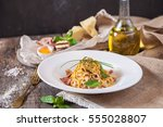 pasta carbonara on white plate... | Shutterstock . vector #555028807