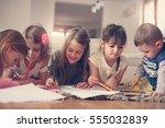 large group of children write... | Shutterstock . vector #555032839