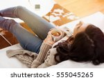 young woman relaxing on sofa... | Shutterstock . vector #555045265