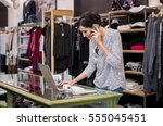 young businesswoman checking... | Shutterstock . vector #555045451