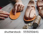cobbler tools in workshop dark... | Shutterstock . vector #555050641